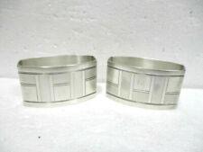Paire de ronds de serviette en métal argenté Art Déco