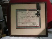 WWI IRON CROSS WITH ORIGINAL PAPER WORK FRAMED WITH PRESENTATION NOTE ON BACK.