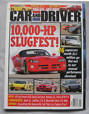 Car & Driver 11/2004 featuirng Porsche Carrera, Ford Mustang, Jeep, AMG Mercedes