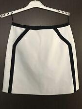 COURRÈGES jupe blanche trapèze T 38 gansée noire, modèle collector neuve