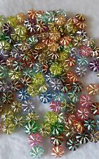 50pcs x 7mm flower beads. Central hole.  * UK SELLER *