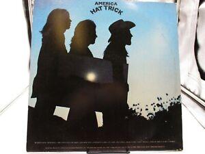 America  – Hat Trick LP 1973 Warner Bros. BS 2728  2 sided poster  VG/VG+ c VG+