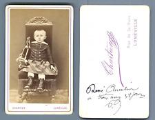 Chartier, Lunéville, Enfant posant avec son jouet  CDV vintage albumen.  Tirag