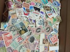 200+ worldwide unchecked off paper stamps mostly different.