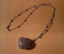 Zilverkleurige lange ketting met hart witte strass hanger