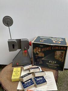 VINTAGE 1950s boxed CHILDREN'S PEAK CINE 16mm PROJECTOR with 7 films metal toy