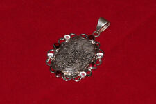 Sterling silver black coral pendant with garnets
