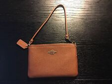 COACH EMBOSSED SMALL ZIP WRISTLET BROWN