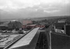 PHOTO  GENERAL VIEW OF LARNE HARBOUR STATION WITH 4 CAR DMU APPROACHING IN DISTA