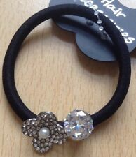 A Beautiful Diamanté And Flower Embellished Hair Bobble.