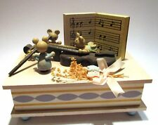 Wooden music box with bunnies with musical instrument
