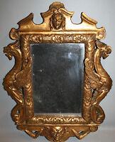 Glace / miroir régence a dragons en bois sculpté doré