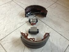 FORD FOCUS MK 1   98-0 TWO REAR WHEEL CYLINDERS &  A SET OF BRAKE SHOES  LH & RH