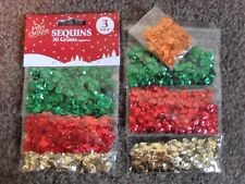 2 PACKS OF CHRISTMAS SEQUINS GREEN, RED, GOLD & ORANGE