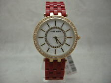 Authentic Anne Klein 2620RDGB Red MOP Dial Acrylic Bracelet Women's Watch