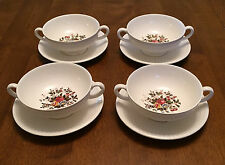 Four Wedgewood cream soup bowls with saucers