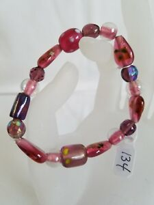 #134 Handcrafted beaded amethyst colored Lampwork glass stretch bracelet