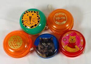 Yo-yo Group of Five - Clear Orange, Cats, and Winnie the Pooh Yo-Yo's