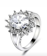 Oval White Sapphire surrounded by CZs in Filled White Gold Ring Size 6
