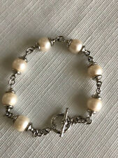 Cultured freshwater pearl and 925 sterling silver bracelet.