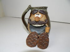 Ugly Funny Face Stoneware Art Mug Seated with his Shoes in Front Robert Eakin