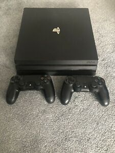 Sony PlayStation 4 Pro (PS4 Pro) 1TB - Black Console w/ 2 controllers
