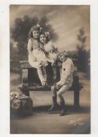 Children On Bench Seat Vintage RPPC Postcard US075