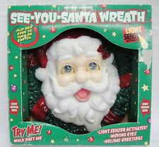 """See You Santa Wreath Light Activated Eyes Move and He Talks 12"""" Plastic Jolly"""