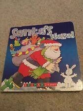 Santa's Here! Board Book