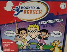 Hooked on French: flashcards, Cds, games and books. 3 sections, 1 open. complete