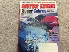2001 Ford Escape, 2000 Cadillac STS, 2000 Acura CL vs BMW 328ci Magazine
