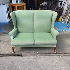More details for vintage parker knoll two-seat wing back sofa in green