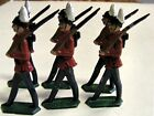 6 MARCHING LEAD SOLDIERS WITH WHITE PLUMES RED COATS BLACK PANTS