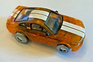 Ford Mustang slot car Tyco translucent orange with double white stripe