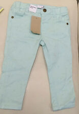 GIRLS PASTEL GREEN 'TARGET' BOW PRINT JEANS. SIZE 6-12 MONTHS. BNWT (C96)