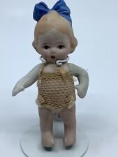 "3 1/2"" bisque Doll. Made in Japan. Arms move."