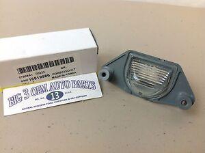 Chevrolet Pontiac GMC Car / Truck Rear LICENSE PLATE LAMP new OEM 16519986
