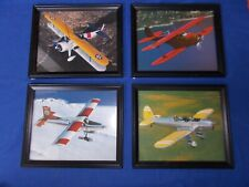 4 color & framed photos of propellor airplanes, plus Fighting Jets book