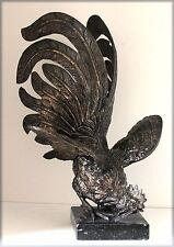 Coq de combat en métal argenté