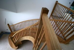 Oak helical custom made staircase production.