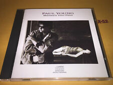 PAUL YOUNG cd BETWEEN TWO FIRES hits WONDERLAND some people WAR GAMES be strong
