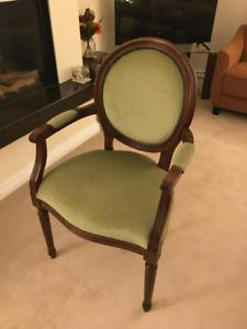 Bedroom chair with arms in green velvet by Stuart Jones.