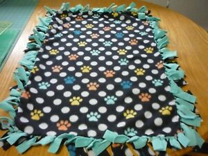 Handmade fleece tie blanket of paws and dots for a small pet