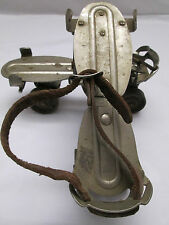 Vintage Chicago Roller Skates with Metal Wheels and Leather Strap