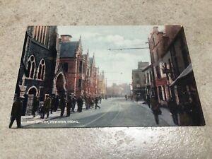 1900s colour postcard .high street  merthyr tydfil with people !