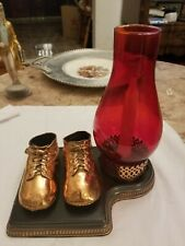 Vintage Bronze Baby Shoes with a candle Stand Craft Desk Deco