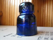 Old glass vintage insulator bright cobalt blue color with seal of factory