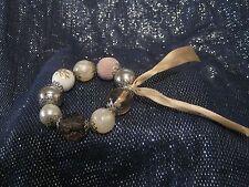 Wonderful elasticated bracelet with large various beads & ribbon