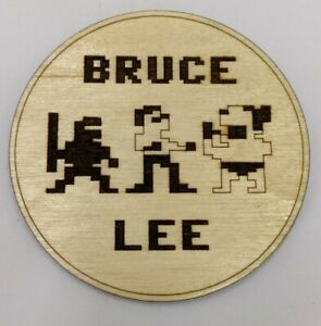 C64 Bruce Lee coaster laser cut from birch ply.