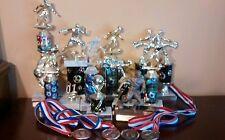11 Male Soccer Trophys & 4 Medals
